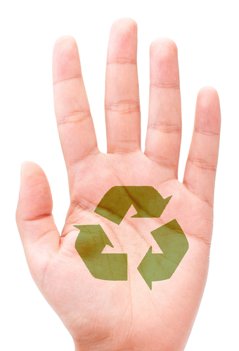Green recycle arrows on the palm of a hand on a white background